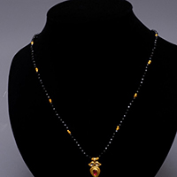 GOLD FACETTED ONYX NECKLACE